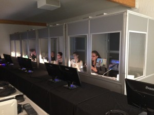 Picture of interpreters at work through remote conference interpreting